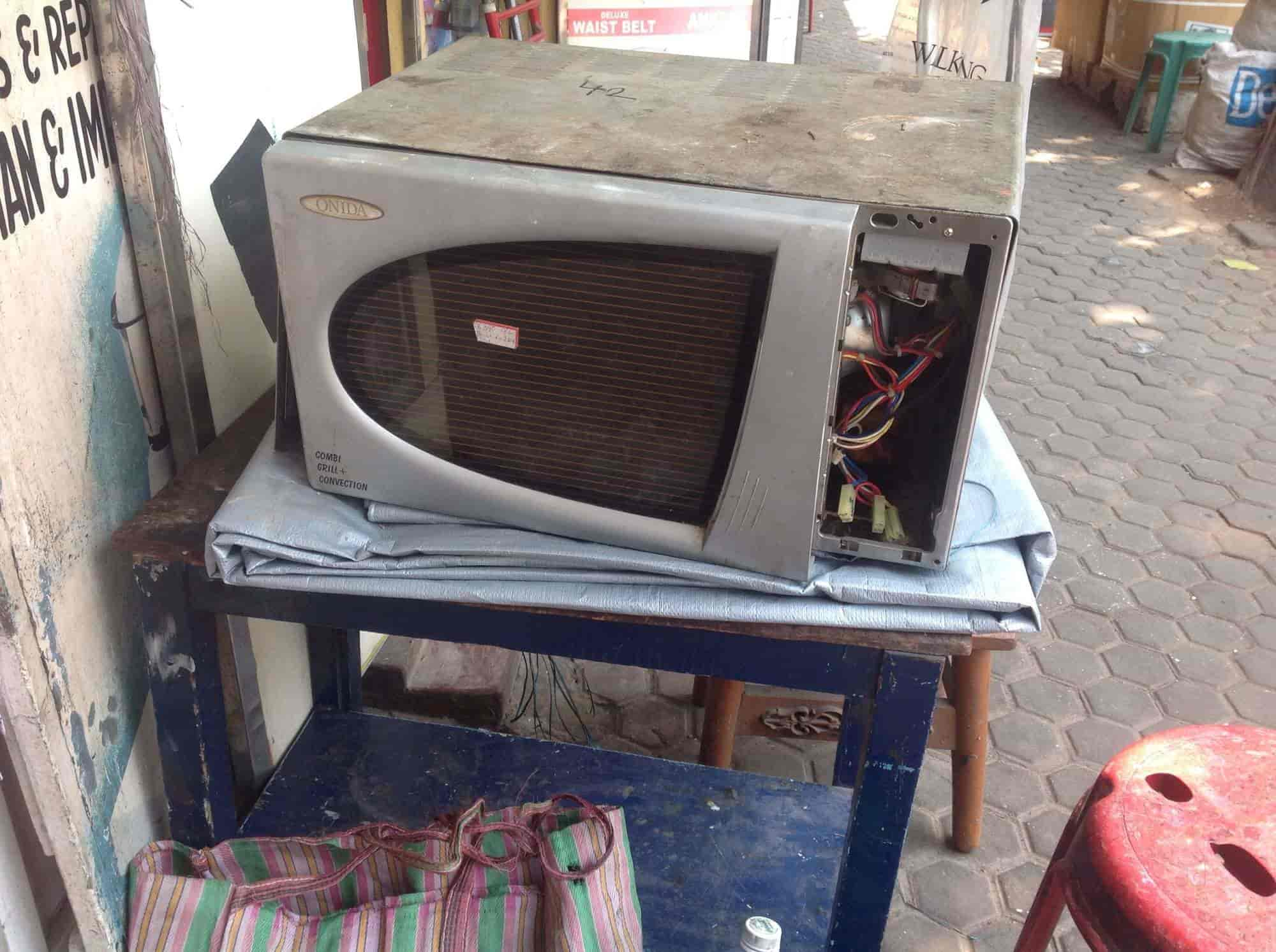 Golden Repair Service Photos Dharmatala Kolkata Microwave Oven Services